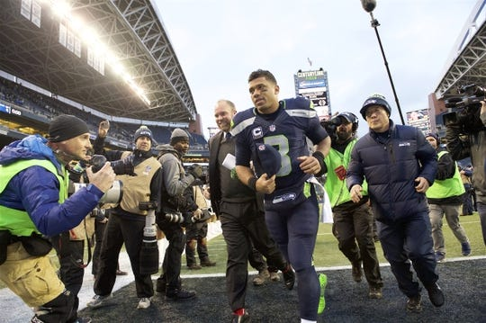 Dec 20, 2015; Seattle, WA, USA; Seattle Seahawks quarterback Russell Wilson runs to the locker room after a game against the Cleveland Browns at CenturyLink Field. The Seahawks won 30-13. Mandatory Credit: Troy Wayrynen-USA TODAY Sports