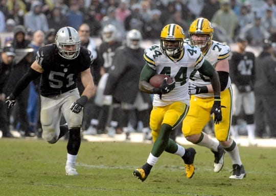 Dec 20, 2015; Oakland, CA, USA; Green Bay Packers running back James Starks (44) is pursued by Oakland Raiders inside linebacker Ben Heeney (51) during an NFL football game at O.co Coliseum. The Packers defeated the Raiders 30-20. Mandatory Credit: Kirby Lee-USA TODAY Sports