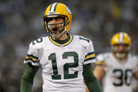 Dec 20, 2015; Oakland, CA, USA; Green Bay Packers quarterback Aaron Rodgers (12) reacts after the Packers were called for a penalty that nullified a touchdown pass against the Oakland Raiders in the fourth quarter at O.co Coliseum. The Packers defeated the Raiders 30-20. Mandatory Credit: Cary Edmondson-USA TODAY Sports