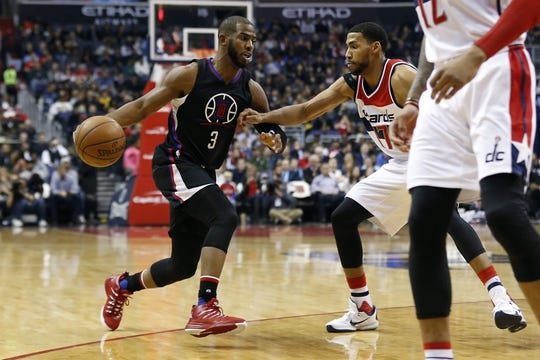 Dec 28, 2015; Washington, DC, USA; Los Angeles Clippers guard Chris Paul (3) dribbles the ball as Washington Wizards guard Garrett Temple (17) defends in the second quarter at Verizon Center. Mandatory Credit: Geoff Burke-USA TODAY Sports
