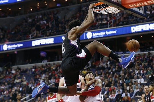 Dec 28, 2015; Washington, DC, USA; Los Angeles Clippers center DeAndre Jordan (6) dunks the ball as Washington Wizards forward Kelly Oubre Jr. (12) looks on in the second quarter at Verizon Center. Mandatory Credit: Geoff Burke-USA TODAY Sports