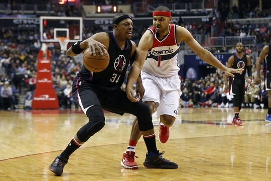 Dec 28, 2015; Washington, DC, USA; Los Angeles Clippers forward Paul Pierce (34) dribbles the ball as Washington Wizards forward Jared Dudley (1) defends in the second quarter at Verizon Center. Mandatory Credit: Geoff Burke-USA TODAY Sports