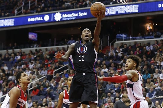 Dec 28, 2015; Washington, DC, USA; Los Angeles Clippers guard Jamal Crawford (11) shoots the ball as Washington Wizards forward Kelly Oubre Jr. (12) looks on in the second quarter at Verizon Center. Mandatory Credit: Geoff Burke-USA TODAY Sports