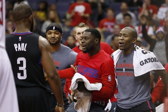 Dec 28, 2015; Washington, DC, USA; Los Angeles Clippers players react on the bench after a dunk by Clippers guard Chris Paul (3) against the Washington Wizards in the second quarter at Verizon Center. Mandatory Credit: Geoff Burke-USA TODAY Sports
