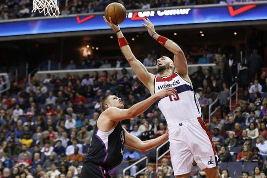 Dec 28, 2015; Washington, DC, USA; Washington Wizards center Marcin Gortat (13) shoots the ball as Los Angeles Clippers center Cole Aldrich (45) defends in the fourth quarter at Verizon Center. The Clippers won 108-91. Mandatory Credit: Geoff Burke-USA TODAY Sports