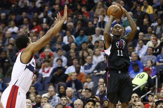 Dec 28, 2015; Washington, DC, USA; Los Angeles Clippers guard Jamal Crawford (11) shoots the ball over Washington Wizards guard Jarell Eddie (8) in the second quarter at Verizon Center. The Clippers won 108-91. Mandatory Credit: Geoff Burke-USA TODAY Sports