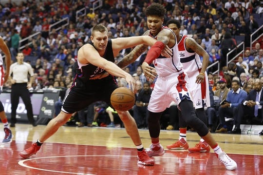 Dec 28, 2015; Washington, DC, USA; Los Angeles Clippers center Cole Aldrich (45) and Washington Wizards forward Kelly Oubre Jr. (12) battle for a loose ball in the second quarter at Verizon Center. The Clippers won 108-91. Mandatory Credit: Geoff Burke-USA TODAY Sports