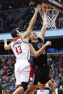 Dec 28, 2015; Washington, DC, USA; Los Angeles Clippers center Cole Aldrich (45) is fouled by Washington Wizards forward Kris Humphries (43) while shooting the ball in the second quarter at Verizon Center. The Clippers won 108-91. Mandatory Credit: Geoff Burke-USA TODAY Sports