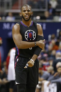 Dec 28, 2015; Washington, DC, USA; Los Angeles Clippers guard Chris Paul (3) reacts while holding his arm after a fall against the Washington Wizards in the second quarter at Verizon Center. The Clippers won 108-91. Mandatory Credit: Geoff Burke-USA TODAY Sports