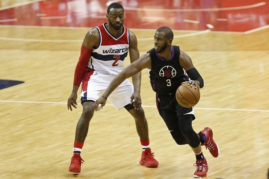 Dec 28, 2015; Washington, DC, USA; Los Angeles Clippers guard Chris Paul (3) dribbles the ball as Washington Wizards guard John Wall (2) defends in the third quarter at Verizon Center. The Clippers won 108-91. Mandatory Credit: Geoff Burke-USA TODAY Sports