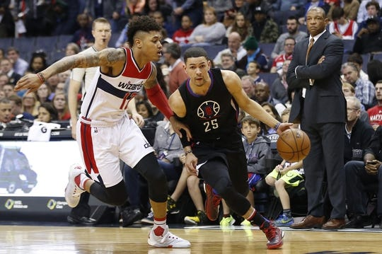 Dec 28, 2015; Washington, DC, USA; Los Angeles Clippers guard Austin Rivers (25) dribbles the ball as Washington Wizards forward Kelly Oubre Jr. (12) defends in the second quarter at Verizon Center. The Clippers won 108-91. Mandatory Credit: Geoff Burke-USA TODAY Sports