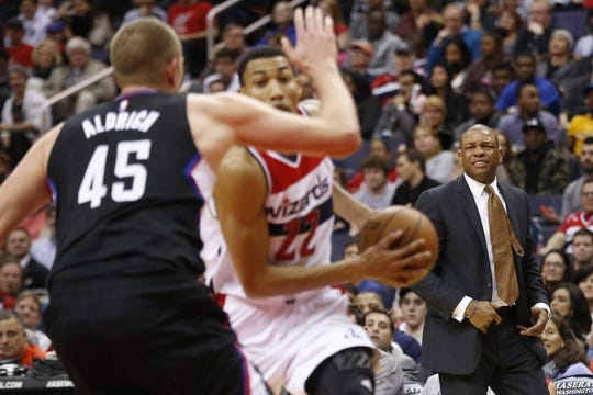 Dec 28, 2015; Washington, DC, USA; Los Angeles Clippers head coach Doc Rivers (R) looks on from the sidelines against the Washington Wizards in the third quarter at Verizon Center. The Clippers won 108-91. Mandatory Credit: Geoff Burke-USA TODAY Sports