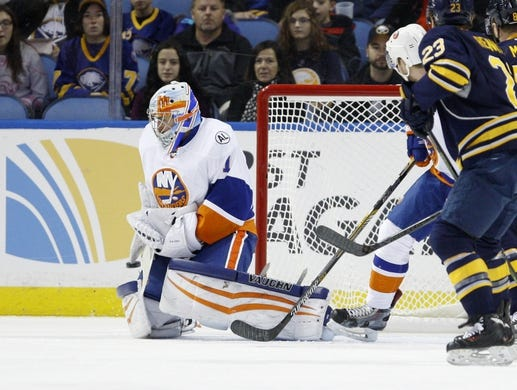 Dec 31, 2015; Buffalo, NY, USA; New York Islanders goalie Thomas Greiss (1) makes a save during the first period against the Buffalo Sabres at First Niagara Center. Mandatory Credit: Timothy T. Ludwig-USA TODAY Sports