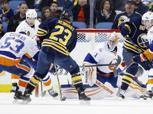 Dec 31, 2015; Buffalo, NY, USA; Buffalo Sabres center Sam Reinhart (23) shoots the puck against New York Islanders goalie Thomas Greiss (1) during the first period at First Niagara Center. Mandatory Credit: Timothy T. Ludwig-USA TODAY Sports
