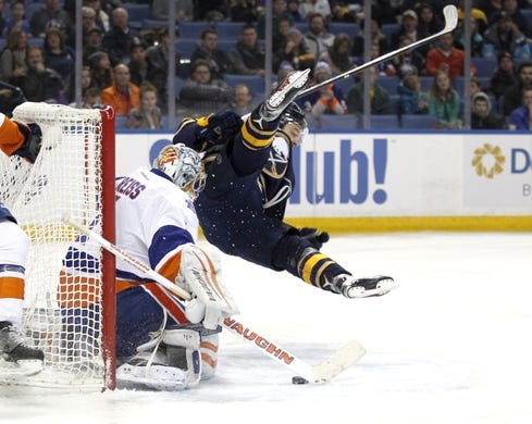 Dec 31, 2015; Buffalo, NY, USA; New York Islanders goalie Thomas Greiss (1) makes a save on Buffalo Sabres center Zemgus Girgensons (28) during the second period at First Niagara Center. Mandatory Credit: Timothy T. Ludwig-USA TODAY Sports