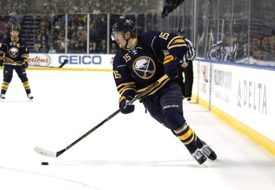 Dec 31, 2015; Buffalo, NY, USA; Buffalo Sabres center Jack Eichel (15) carries the puck during the second period against the New York Islanders at First Niagara Center. Mandatory Credit: Timothy T. Ludwig-USA TODAY Sports