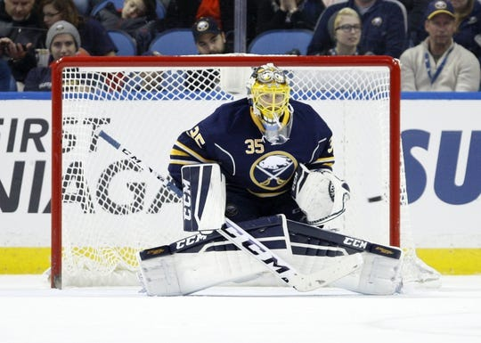 Dec 31, 2015; Buffalo, NY, USA; Buffalo Sabres goalie Linus Ullmark (35) looks to make a save during the second period against the New York Islanders at First Niagara Center. Mandatory Credit: Timothy T. Ludwig-USA TODAY Sports