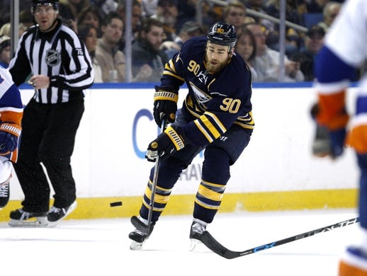 Dec 31, 2015; Buffalo, NY, USA; Buffalo Sabres center Ryan O'Reilly (90) shoots the puck up ice during the second period against the New York Islanders at First Niagara Center. Mandatory Credit: Timothy T. Ludwig-USA TODAY Sports