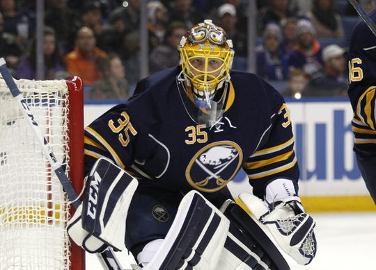 Dec 31, 2015; Buffalo, NY, USA; Buffalo Sabres goalie Linus Ullmark (35) looks for the puck during the third period against the New York Islanders at First Niagara Center. Islanders beat the Sabres 2-1. Mandatory Credit: Timothy T. Ludwig-USA TODAY Sports