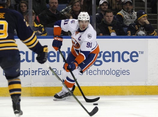 Dec 31, 2015; Buffalo, NY, USA; New York Islanders center John Tavares (91) looks to make a pass during the third period against the Buffalo Sabres at First Niagara Center. Islanders beat the Sabres 2-1. Mandatory Credit: Timothy T. Ludwig-USA TODAY Sports