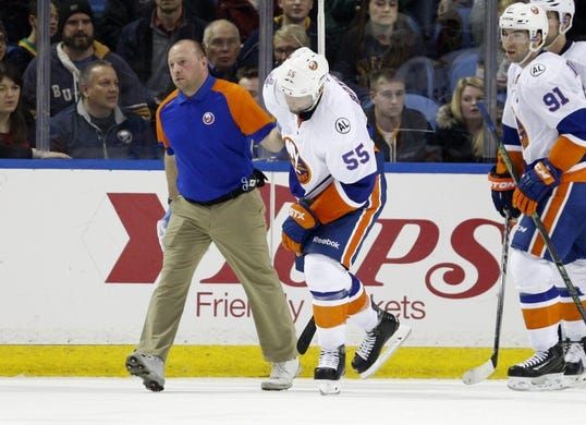 Dec 31, 2015; Buffalo, NY, USA; New York Islanders defenseman Johnny Boychuk (55) goes off the ice with a trainer during the third period against the Buffalo Sabres at First Niagara Center. Islanders beat the Sabres 2-1. Mandatory Credit: Timothy T. Ludwig-USA TODAY Sports