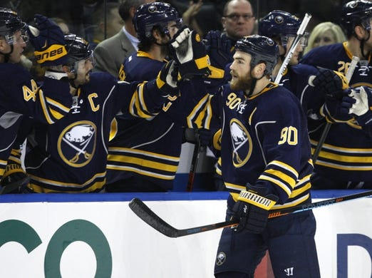 Dec 31, 2015; Buffalo, NY, USA; Buffalo Sabres center Ryan O'Reilly (90) celebrates his goal during the third period against the New York Islanders at First Niagara Center. Islanders beat the Sabres 2-1. Mandatory Credit: Timothy T. Ludwig-USA TODAY Sports