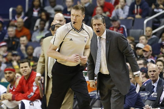 Dec 28, 2015; Washington, DC, USA; (Editors note: Caption correction) Washington Wizards head coach Randy Wittman (R) yells at referee Ed Malloy from the bench against the Los Angeles Clippers in the second quarter at Verizon Center. The Clippers won 108-91. Mandatory Credit: Geoff Burke-USA TODAY Sports