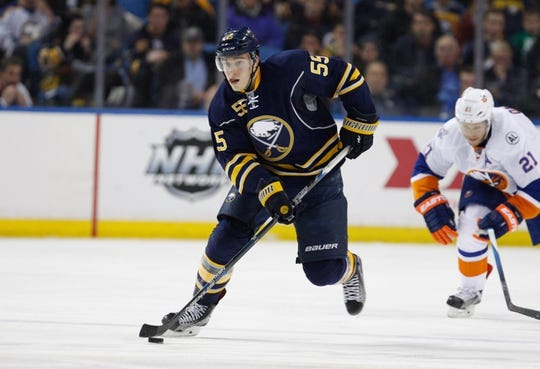 Dec 31, 2015; Buffalo, NY, USA; Buffalo Sabres defenseman Rasmus Ristolainen (55) against the New York Islanders at First Niagara Center. Mandatory Credit: Timothy T. Ludwig-USA TODAY Sports