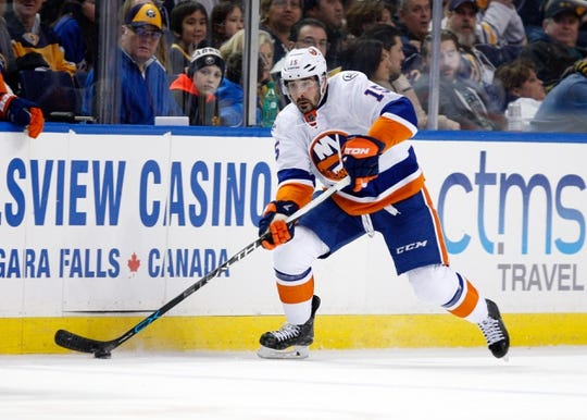 Dec 31, 2015; Buffalo, NY, USA; New York Islanders right wing Cal Clutterbuck (15) against the Buffalo Sabres at First Niagara Center. Islanders beat the Sabres 2 to 1. Mandatory Credit: Timothy T. Ludwig-USA TODAY Sports