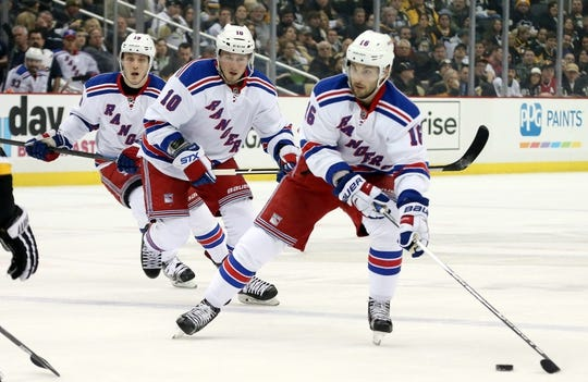 Feb 10, 2016; Pittsburgh, PA, USA; New York Rangers center Derick Brassard (16) leads center J.T. Miller (10) and right wing Jesper Fast (19) into the offensive zone against the Pittsburgh Penguins during the first period at the CONSOL Energy Center. Mandatory Credit: Charles LeClaire-USA TODAY Sports