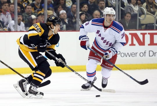 Feb 10, 2016; Pittsburgh, PA, USA; Pittsburgh Penguins left wing Carl Hagelin (62) sktes with the puck against New York Rangers left wing Chris Kreider (20) during the first period at the CONSOL Energy Center. Mandatory Credit: Charles LeClaire-USA TODAY Sports