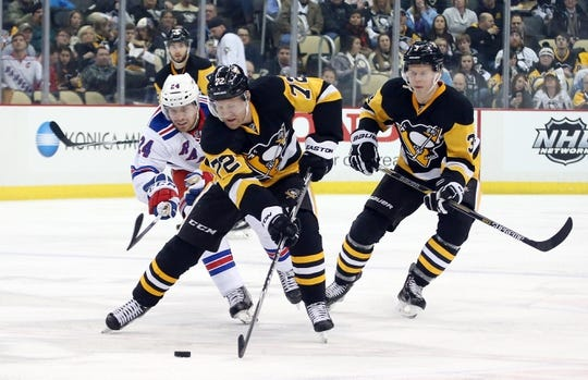 Feb 10, 2016; Pittsburgh, PA, USA; Pittsburgh Penguins right wing Patric Hornqvist (72) moves the puck up ice as New York Rangers center Oscar Lindberg (24) chases during the second period at the CONSOL Energy Center. Mandatory Credit: Charles LeClaire-USA TODAY Sports