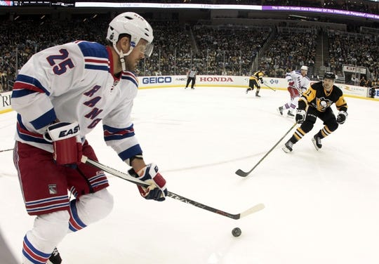 Feb 10, 2016; Pittsburgh, PA, USA; New York Rangers left wing Viktor Stalberg (25) moves the puck against the Pittsburgh Penguins during the second period at the CONSOL Energy Center. The Rangers shutout the Penguins 3-0. Mandatory Credit: Charles LeClaire-USA TODAY Sports