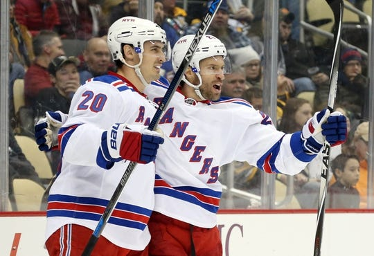 Feb 10, 2016; Pittsburgh, PA, USA; New York Rangers left wing Chris Kreider (20) and center Dominic Moore (R) celebrate after Moore scored a goal against the Pittsburgh Penguins during the third period at the CONSOL Energy Center. The Rangers shutout the Penguins 3-0. Mandatory Credit: Charles LeClaire-USA TODAY Sports
