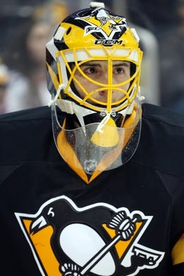 Feb 10, 2016; Pittsburgh, PA, USA; Pittsburgh Penguins goalie Marc-Andre Fleury (29) looks on against the New York Rangers during the third period at the CONSOL Energy Center. The Rangers shutout the Penguins 3-0. Mandatory Credit: Charles LeClaire-USA TODAY Sports