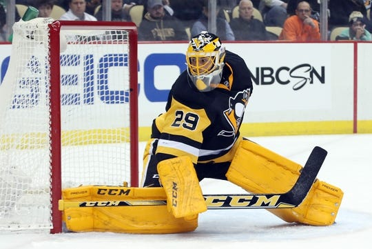 Feb 10, 2016; Pittsburgh, PA, USA; Pittsburgh Penguins goalie Marc-Andre Fleury (29) guards the net against the New York Rangers during the first period at the CONSOL Energy Center. The Rangers won 3-0. Mandatory Credit: Charles LeClaire-USA TODAY Sports