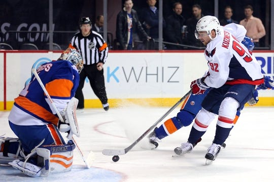 Feb 18, 2016; Brooklyn, NY, USA; New York Islanders goalie Thomas Greiss (1) makes a save against Washington Capitals center Evgeny Kuznetsov (92) during the first period at Barclays Center. Mandatory Credit: Brad Penner-USA TODAY Sports