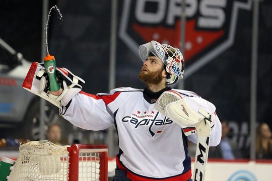 Feb 18, 2016; Brooklyn, NY, USA; Washington Capitals goalie Braden Holtby (70) squeezes water from his water bottle during the second period against the New York Islanders at Barclays Center. Mandatory Credit: Brad Penner-USA TODAY Sports