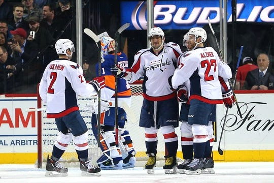 Feb 18, 2016; Brooklyn, NY, USA; Washington Capitals left wing Alex Ovechkin (8) celebrates his goal against New York Islanders goalie Thomas Greiss (1) with teammates during the second period at Barclays Center. Mandatory Credit: Brad Penner-USA TODAY Sports