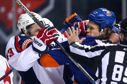 Feb 18, 2016; Brooklyn, NY, USA; Washington Capitals right wing Tom Wilson (43) and New York Islanders left wing Matt Martin (17) are separated during the second period at Barclays Center. Mandatory Credit: Brad Penner-USA TODAY Sports