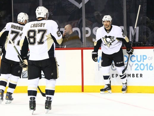 Mar 8, 2016; Brooklyn, NY, USA; Pittsburgh Penguins defenseman Kris Letang (58) reacts with his teammates after scoring a first period goal against the New York Islanders at Barclays Center. Mandatory Credit: Andy Marlin-USA TODAY Sports