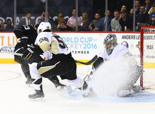 Mar 8, 2016; Brooklyn, NY, USA; Pittsburgh Penguins goaltender Marc-Andre Fleury (29) makes a save against and New York Islanders center Casey Cizikas (53) during the second period at Barclays Center. Mandatory Credit: Andy Marlin-USA TODAY Sports