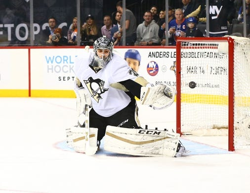 Mar 8, 2016; Brooklyn, NY, USA; Pittsburgh Penguins  goaltender Marc Andre-Fleury (29) plays the puck against the New York Islanders at Barclays Center. Mandatory Credit: Andy Marlin-USA TODAY Sports