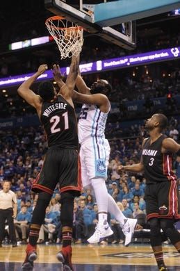 Apr 29, 2016; Charlotte, NC, USA; Charlotte Hornets forward center Al Jefferson (25) moves to the basket and scores as he is defended by Miami center Hassan Whiteside (21) during the first half in game six of the first round of the NBA Playoffs at Time Warner Cable Arena. Mandatory Credit: Sam Sharpe-USA TODAY Sports