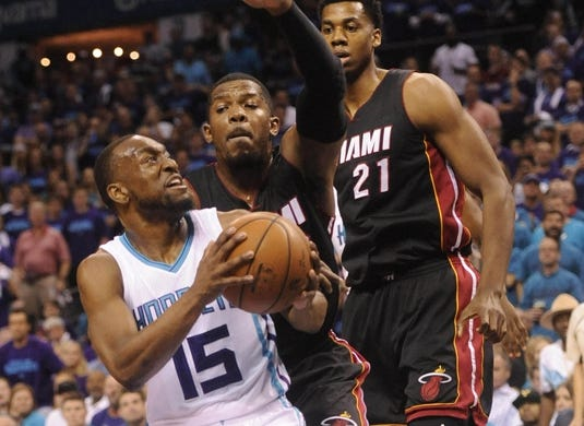 Apr 29, 2016; Charlotte, NC, USA; Charlotte Hornets guard Kemba Walker (15) looks to shoot as he is defended by Miami Heat forward Joe Johnson (2) during the first half in game six of the first round of the NBA Playoffs at Time Warner Cable Arena. Mandatory Credit: Sam Sharpe-USA TODAY Sports