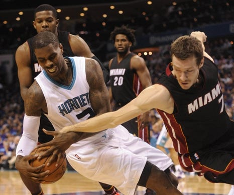 Apr 29, 2016; Charlotte, NC, USA; Charlotte Hornets forward Marvin Williams (2) and Miami Heat guard Goran Tragic (7) go after a loose ball during the first half in game six of the first round of the NBA Playoffs at Time Warner Cable Arena. Mandatory Credit: Sam Sharpe-USA TODAY Sports