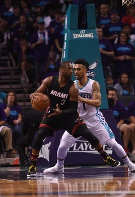 Apr 29, 2016; Charlotte, NC, USA; Miami Heat guard Dwyane Wade (3) looks to shoot as he is defended by Charlotte Hornets guard Courtney Lee (1) during the first half in game six of the first round of the NBA Playoffs at Time Warner Cable Arena. Mandatory Credit: Sam Sharpe-USA TODAY Sports