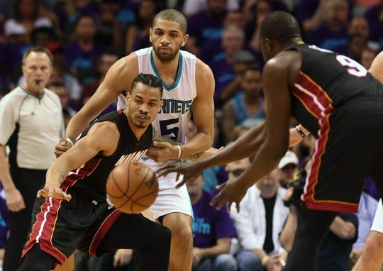Apr 29, 2016; Charlotte, NC, USA; Miami Heat guard forward Gerald Green (14) reaches out to catch a pass from forward Luol Deng (9) during the first half in game six of the first round of the NBA Playoffs against the Charlotte Hornet at Time Warner Cable Arena. Mandatory Credit: Sam Sharpe-USA TODAY Sports