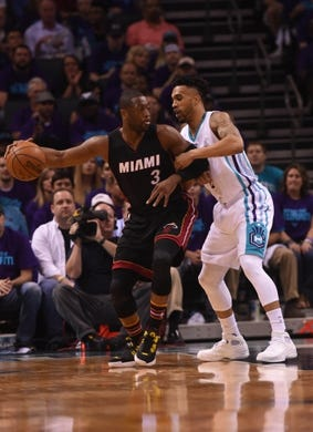 Apr 29, 2016; Charlotte, NC, USA; Miami Heat guard Dwyane Wade (3) looks to pass as he is defended by Charlotte Hornets guard Courtney Lee (1) during the first half in game six of the first round of the NBA Playoffs at Time Warner Cable Arena. Mandatory Credit: Sam Sharpe-USA TODAY Sports