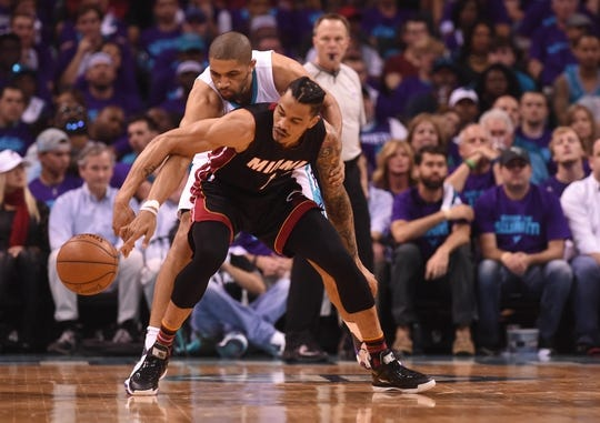 Apr 29, 2016; Charlotte, NC, USA; Miami Heat guard forward Gerald Green (14) gets the ball knocked away by Charlotte Hornets guard forward Nicolas Batum (5) during the first half in game six of the first round of the NBA Playoffs at Time Warner Cable Arena. Mandatory Credit: Sam Sharpe-USA TODAY Sports